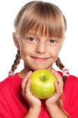Little girl with apple — Stock Photo