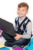 Boy with laptop and books — Stock Photo