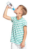 Boy with bottle of water — Stock Photo