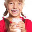 Stock Photo: Little girl with glass of milk