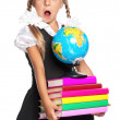 Little girl with globe and books — Stock Photo
