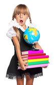 Holčička s globe a knihy — Stock fotografie