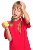 Little girl with lemon — Stock Photo