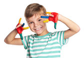Little boy with paints on hands — Stock Photo
