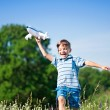 Boy with plane — Stock Photo #19737133