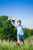 Boy with plane — Stock Photo
