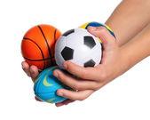Nas mãos do menino com bolinhas — Foto Stock