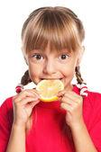 Little girl with lemon — Zdjęcie stockowe