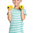 Stock Photo: Little boy with dumbbells