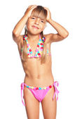 Little girl in swimsuit — Stock Photo