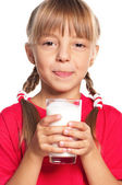 Little girl with glass of milk — Stock Photo
