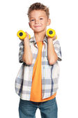Little boy with dumbbells — Stock Photo