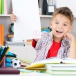 Boy doing homework — Stockfoto
