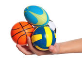 Boy hand with small balls — Stock Photo