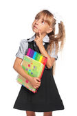 Little girl with exercise books — Stock Photo