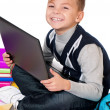 Boy with laptop and books — Stock Photo #35261899