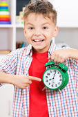 Boy with alarm clock — Stock Photo