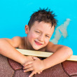 Stock Photo: Kid elbowing at swimming pool