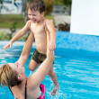 Woman lifting up her son — Stock Photo #12393875