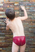 Child under the shower — Stock Photo