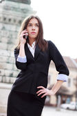 Attractive businesswoman with cell — Stok fotoğraf