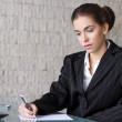 Businesswoman writing letter — Stock Photo