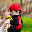 Stock Photo: Mother and son with flowers