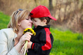 Mother and son with flowers — Stock Photo