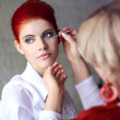 Stock Photo: Makeup artist cleaning eyeshadow