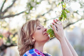 Beautiful blonde woman at spring — Stock Photo