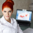 Royalty-Free Stock Photo: Redhead businesswoman smiling