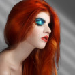 Redhead beauty with aqua blue makeup — Stock Photo