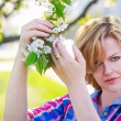 Woman holding flower — Stock Photo
