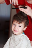 Boy with mother haircut — Stock Photo