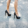 Female high heeled red shoes on way — Stock Photo #25081265