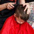 Haircut for boy at home with machine — Stock Photo
