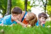 Happy caucasian family in nature — Stock Photo