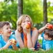 Healthy family with apple — Stock Photo