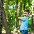 Kid with branch — Stock Photo