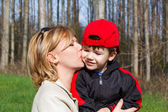 Mother hug son at park — Stock Photo