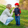 Royalty-Free Stock Photo: Son give dandelion for mother