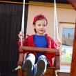 Preschooler boy swinging — Stock Photo
