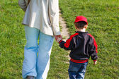 Mother holding son hand — Stock Photo