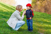 Son give dandelion for mother — Stock Photo