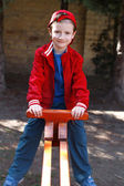 Little boy on double swing — Stock Photo