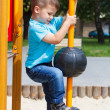 Little child climb at playground — Stock Photo