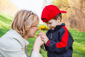 Little boy give flower to mom — Stock Photo