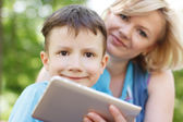 Boy and mother with tablet — Stock Photo
