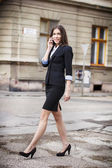 Confident businesswoman calling — Stockfoto