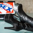 Sex, drug, rock and roll, black woman high heel boots — Stock Photo